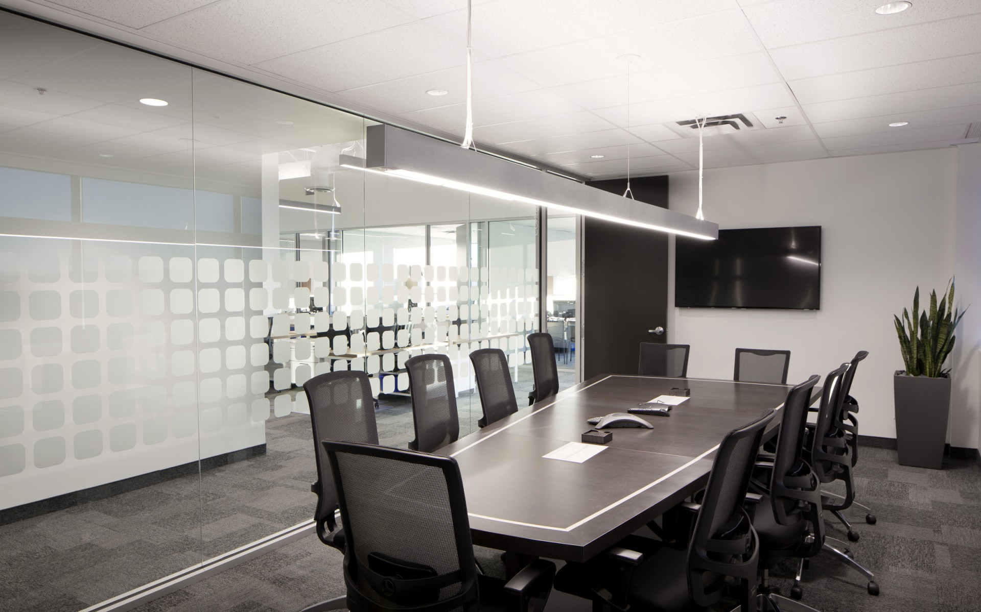 Lumenline Pendants also provide bright ambient lighting for the office's work spaces and conference rooms.