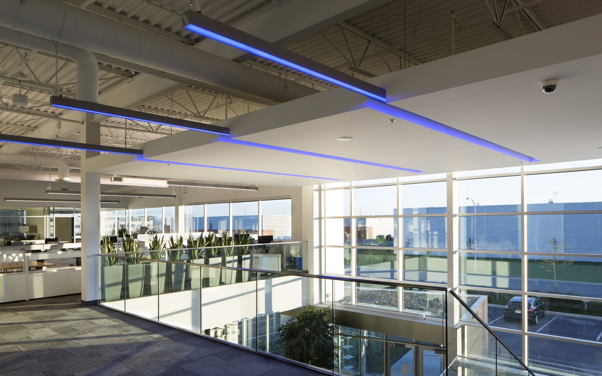 The atrium is illuminated with Lumenline RGB luminaires, creating continuous lines of color.