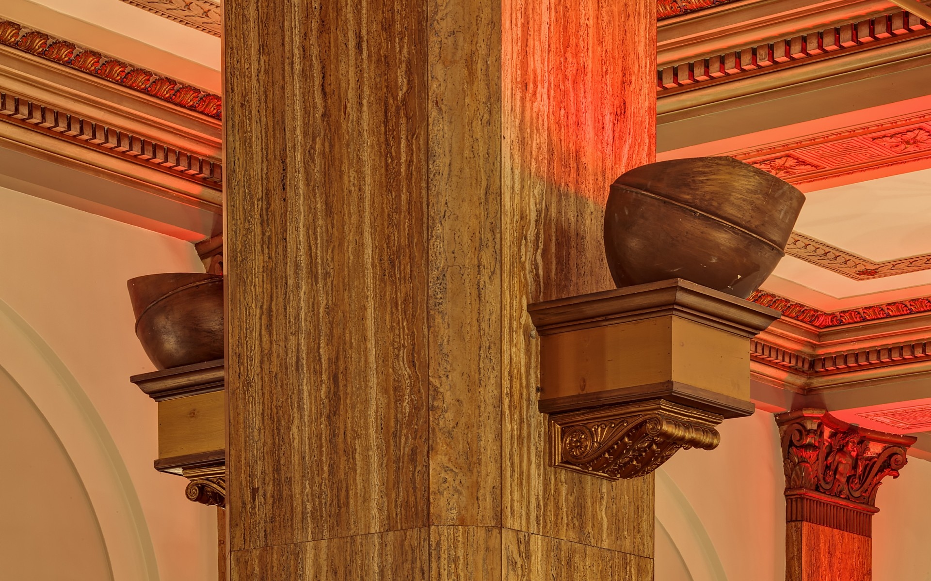 The luminaires were installed inside sconces attached to large ornate columns.