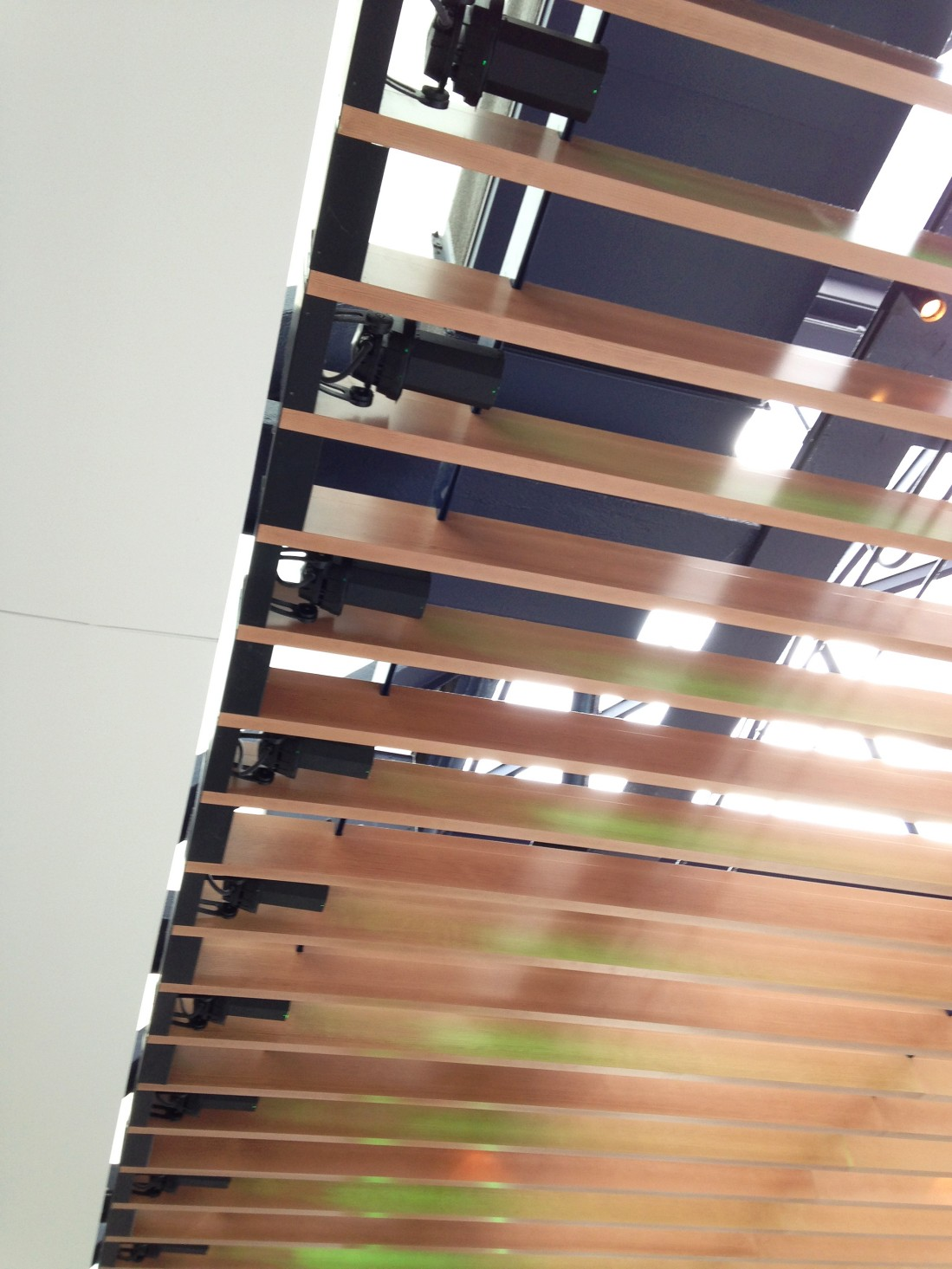 Lumenbeam Medium RGB luminaires with a  6-degree beam are mounted in between slats at the top.