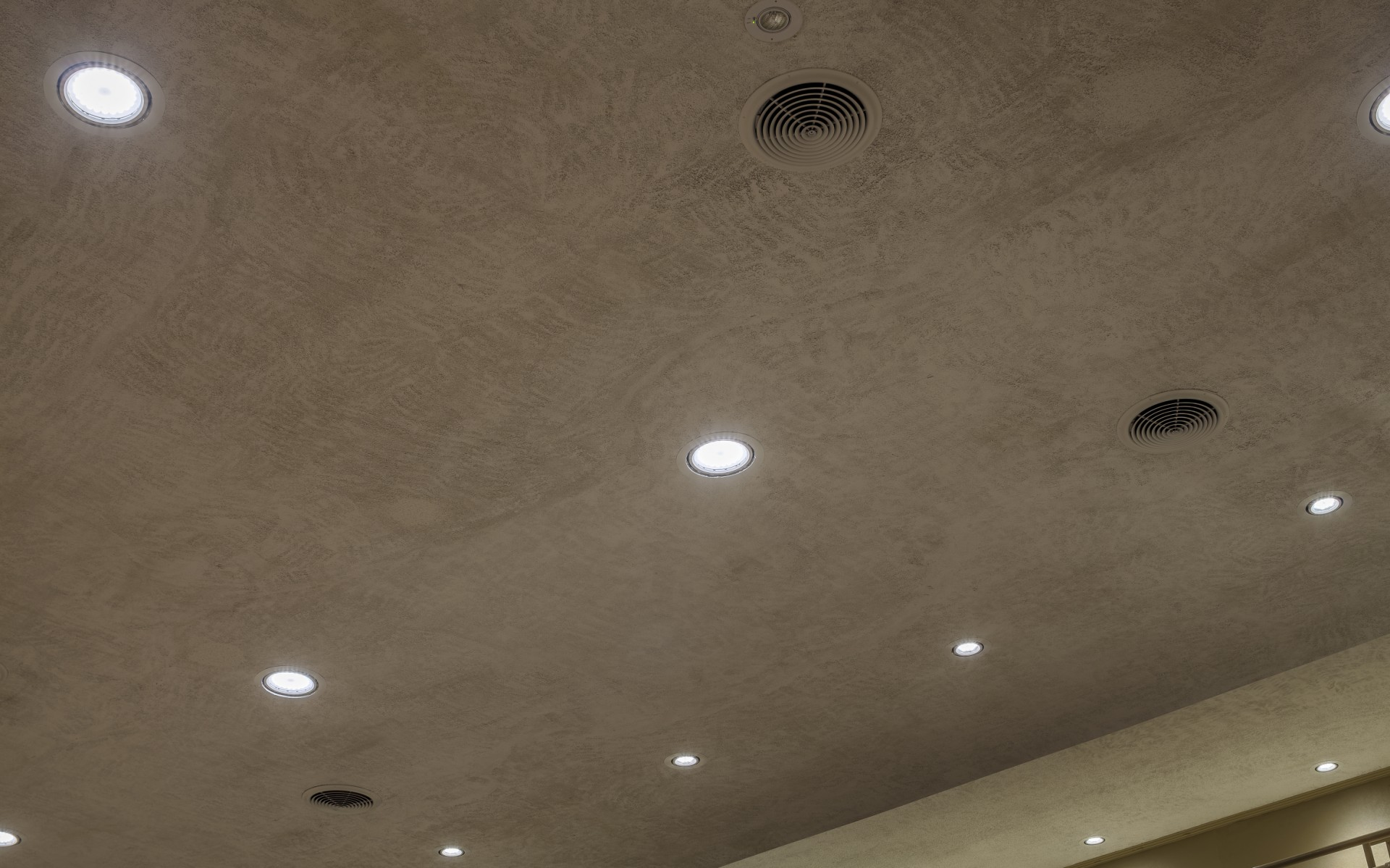 The luminaires were installed in existing openings using L-brackets that could be mounted from below.