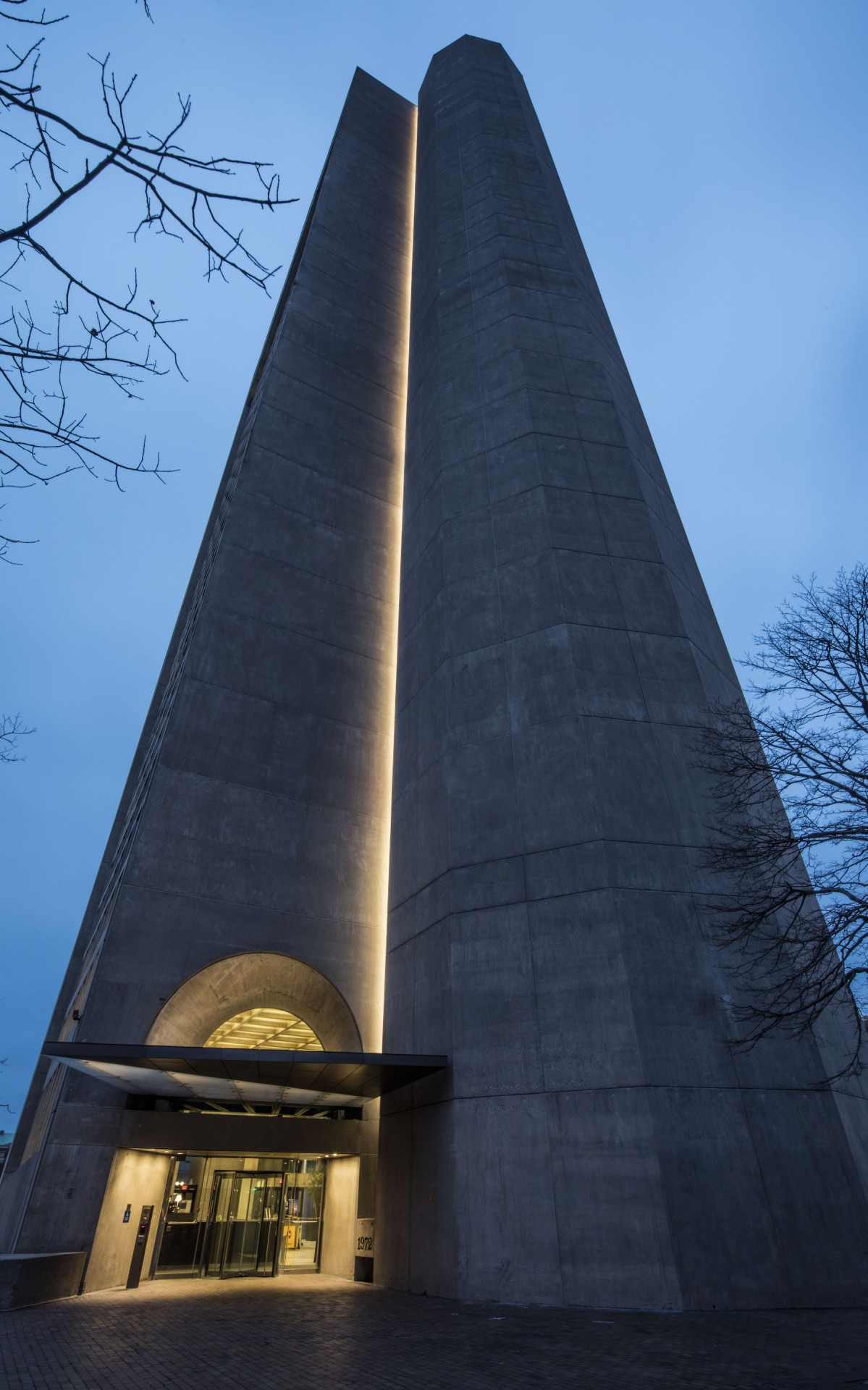 The luminaires are installed in a vertical niche along the length of the tower.