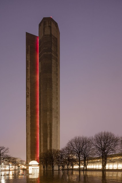 This creates a unified, illuminated line emphasizing the building's height and brutalist architecture.