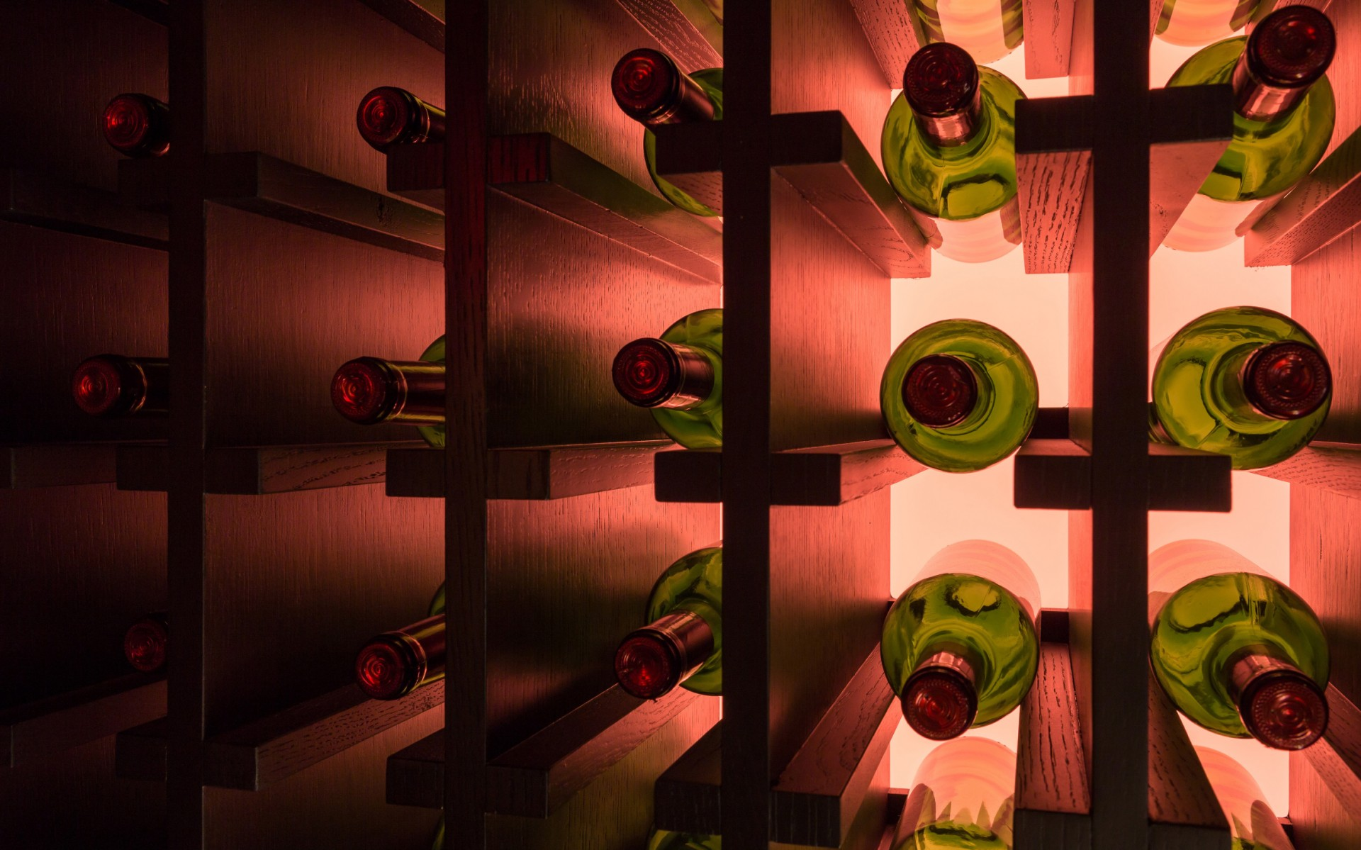 Interior Lumenfacade RGBW fixtures were used to backlight the wine rack.