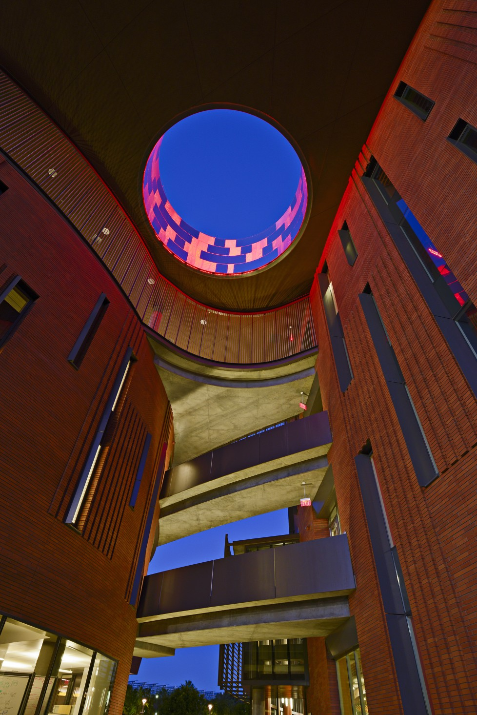 The lighting design links the building's two wings and accentuates its distinct layout.