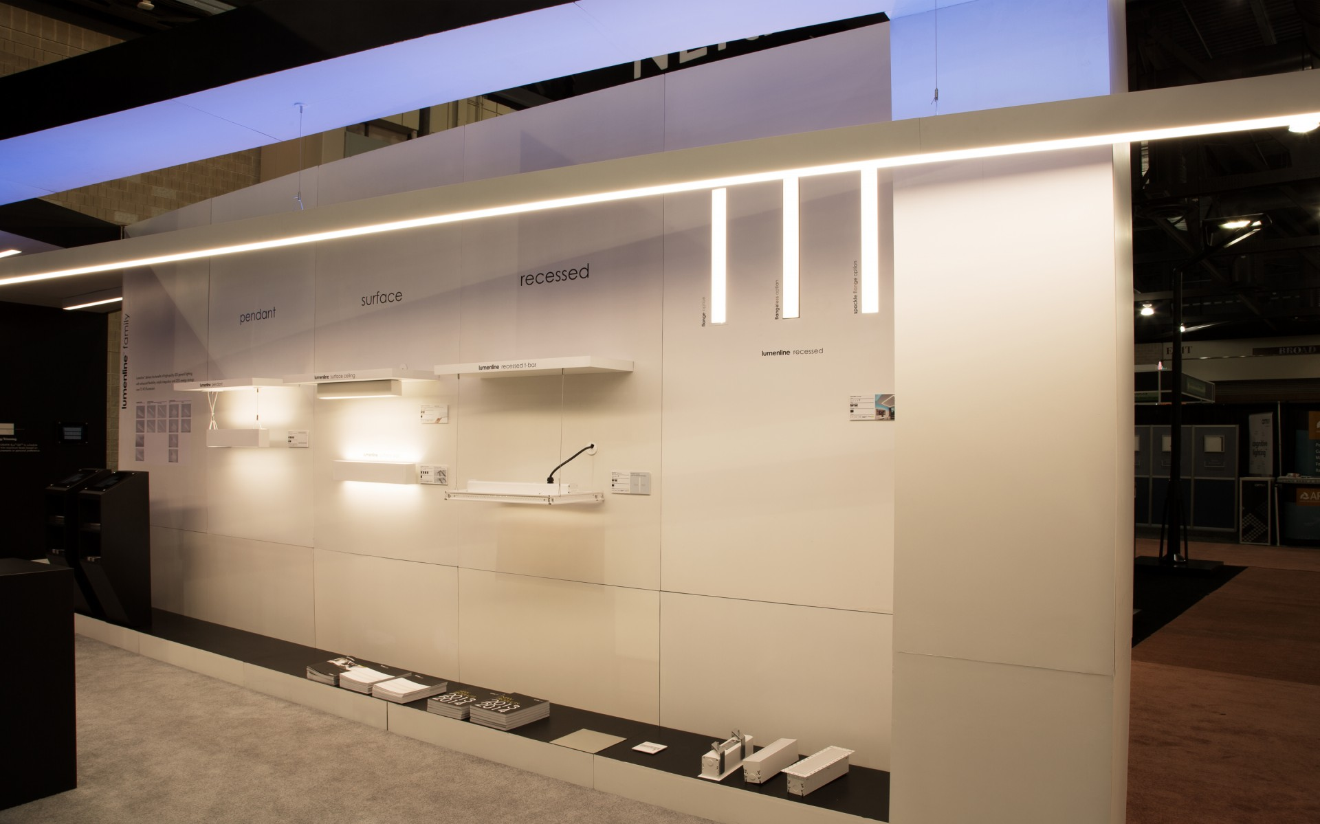 The Lumenline wall, with Lumenline Pendant Direct/Indirect hanging overhead. (Lumenpulse booth, Lightfair 2013)