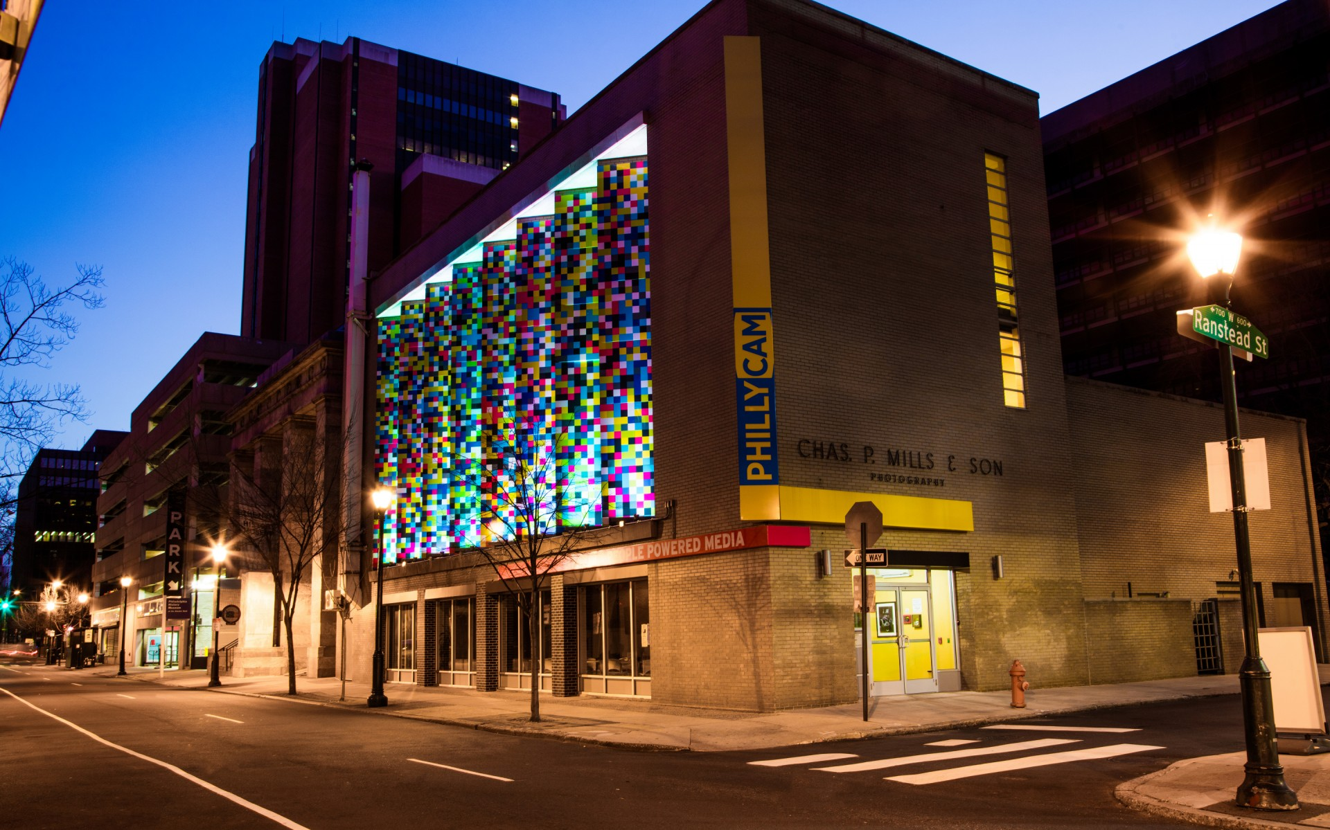 A mix of Lumenbeam and Lumenfacade Color Changing luminaires  were used to bring a unique TV static motif to life.