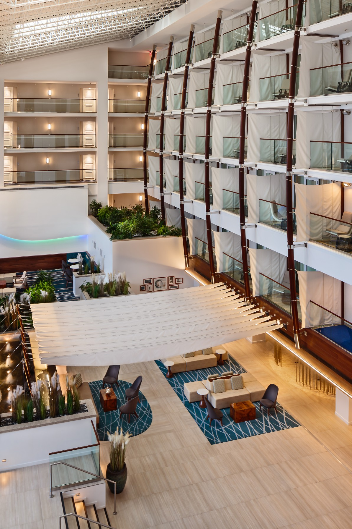 In the hotel's atrium – an impressively tall space – the cove fixtures were installed in the feature wave-like undulating wall niche.  – Roberto Farren
