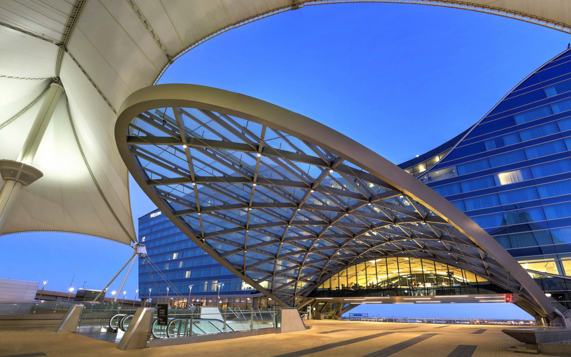 A compliment to the airport's famous tented architecture, the metal and glass canopies above the airport train station are eye-catching and can be seen from afar. – Ryan Linton