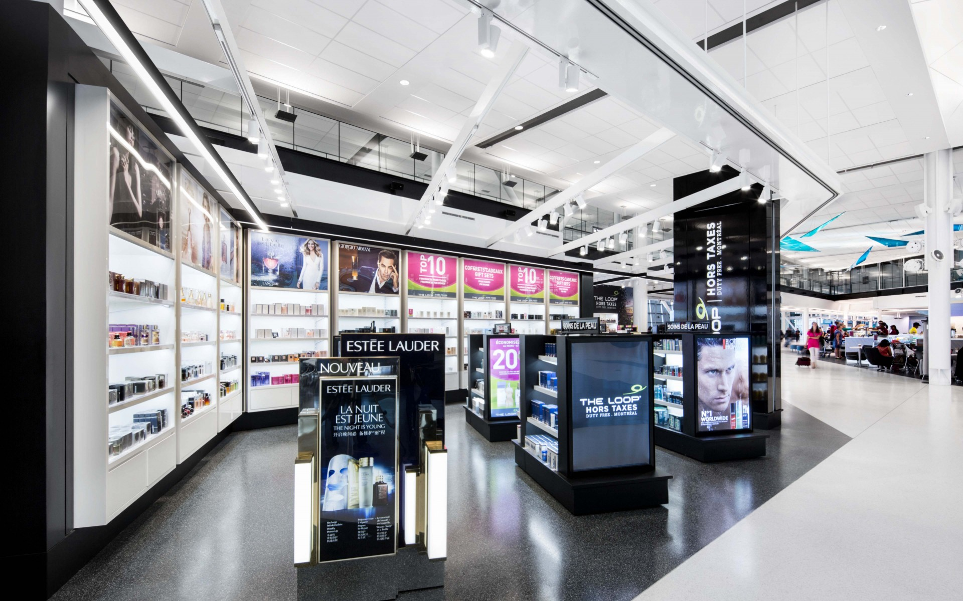 "The gleaming shops that make up the Pierre Elliott International Airport's Duty-Free area known as ""The Loop"" are aglow due to recent renovations. – Stéphane Brügger"