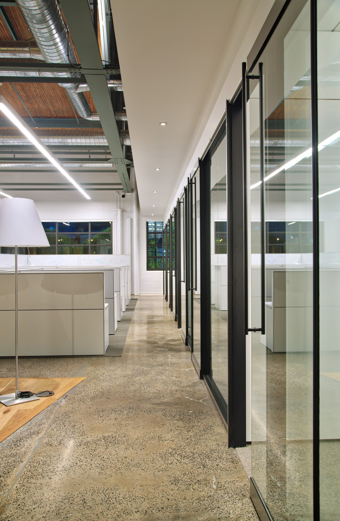 Simultaneously, the executive office area uses Downlight Pinhole Small units, which were made trimless and given spackle flanges to provide a distinct, yet fluid, bridge to the space surrounding it.