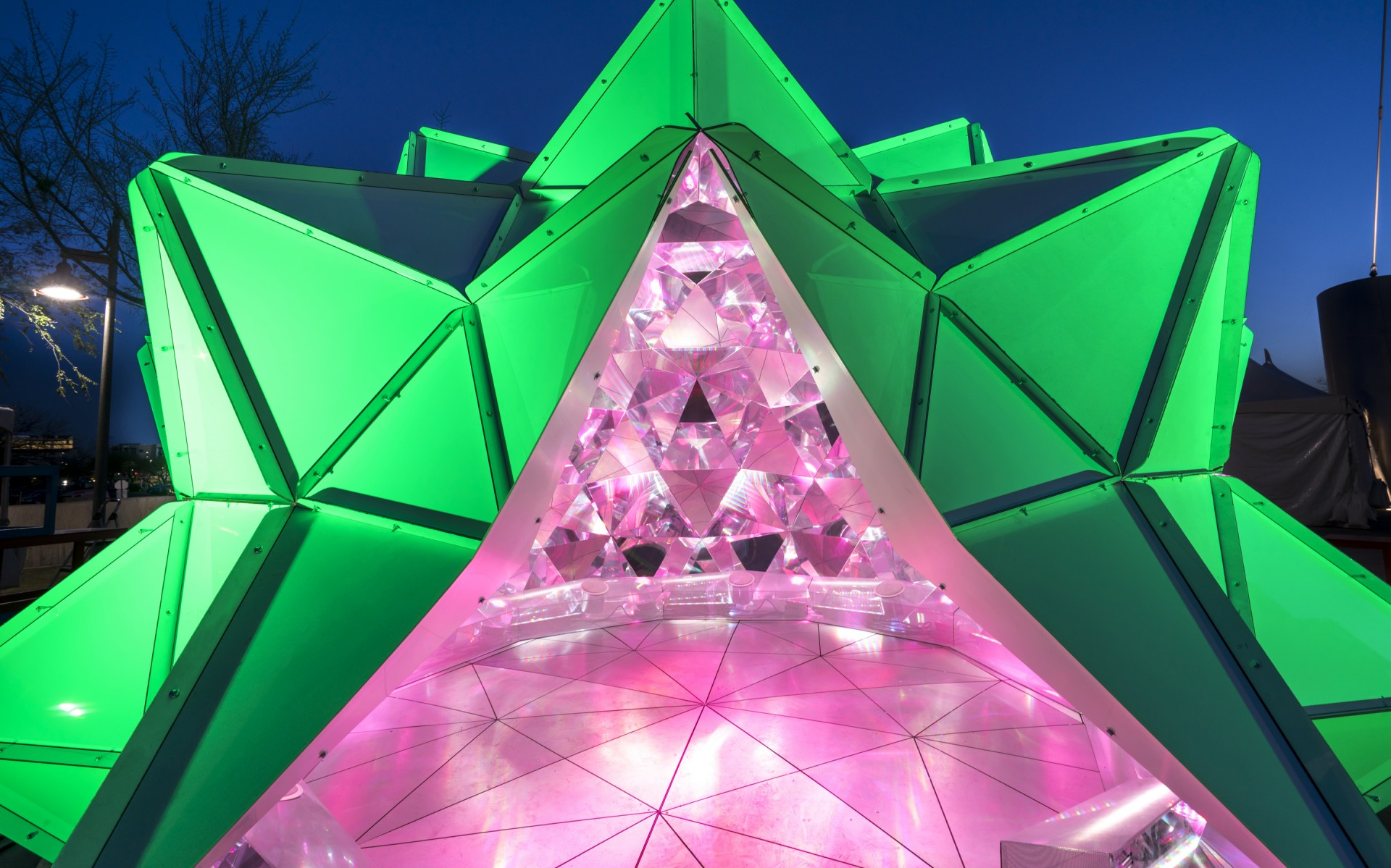 The installation uses four Lumenbeam Large Color Changing luminaires with a narrow, 20-degree beam angle to illuminate the exterior of the dome. – Sean Deckert
