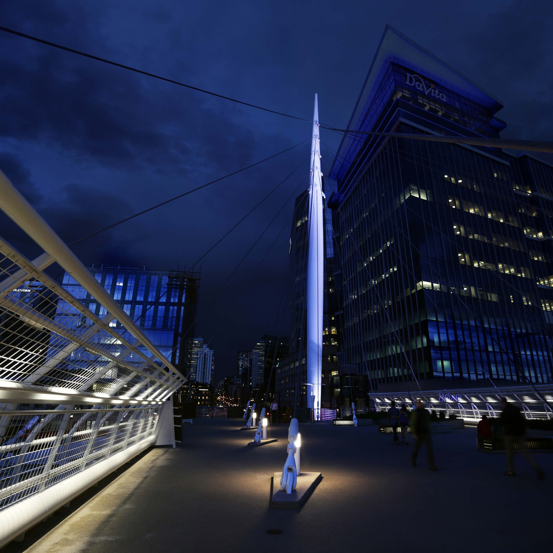 The 200-foot white tapered-steel mast is emboldened against the city's night sky – RLI Photography