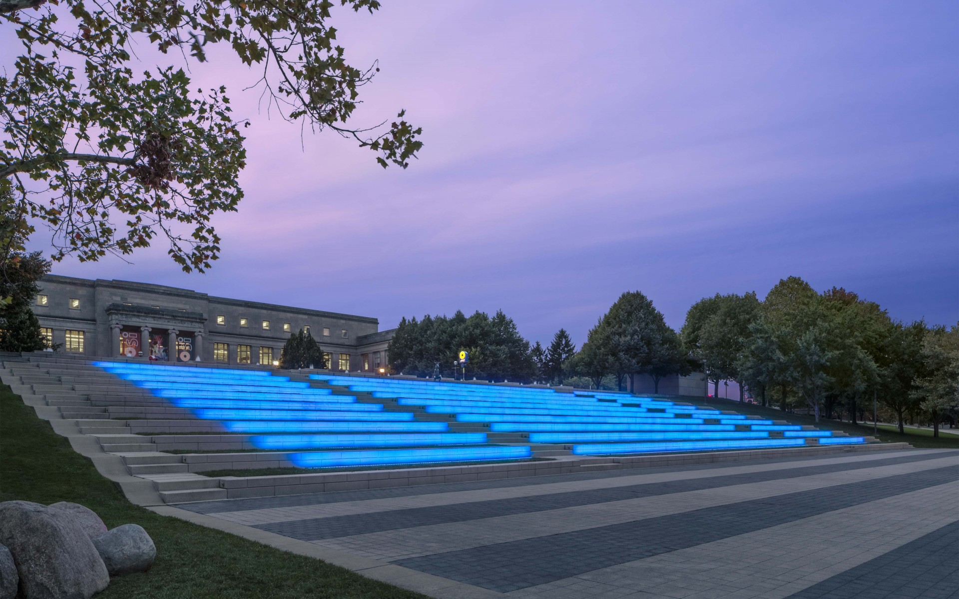 Lighting designers, Illumination Arts, have created a lighting scheme that is both a tribute and an attraction, rebranding the amphitheater as a welcoming, multi-use space.  – Feinknopf Photography