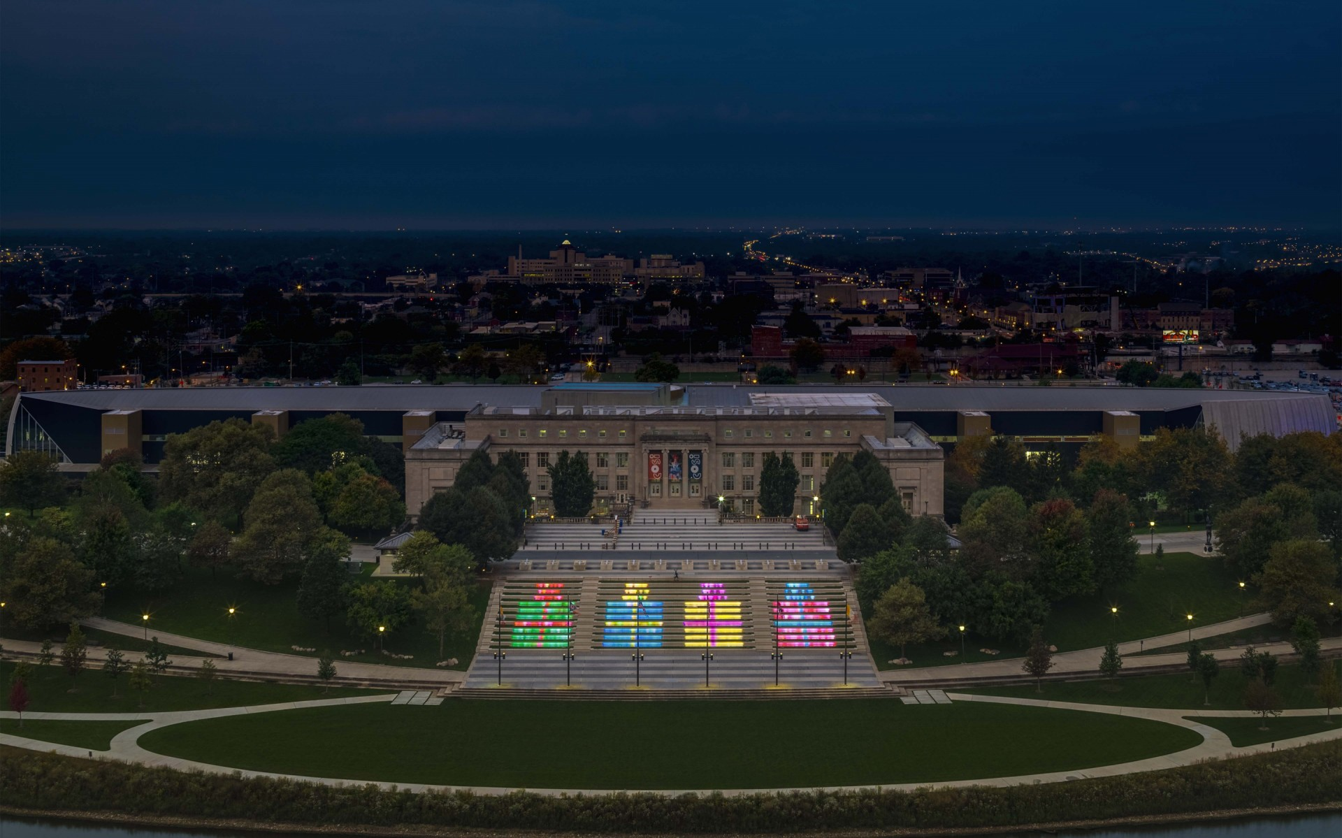 Illumination Arts created a low-res screen on the stairs as well as to create objects and gateways surrounding the amphitheater that interacted with people's presence.  – Feinknopf Photography