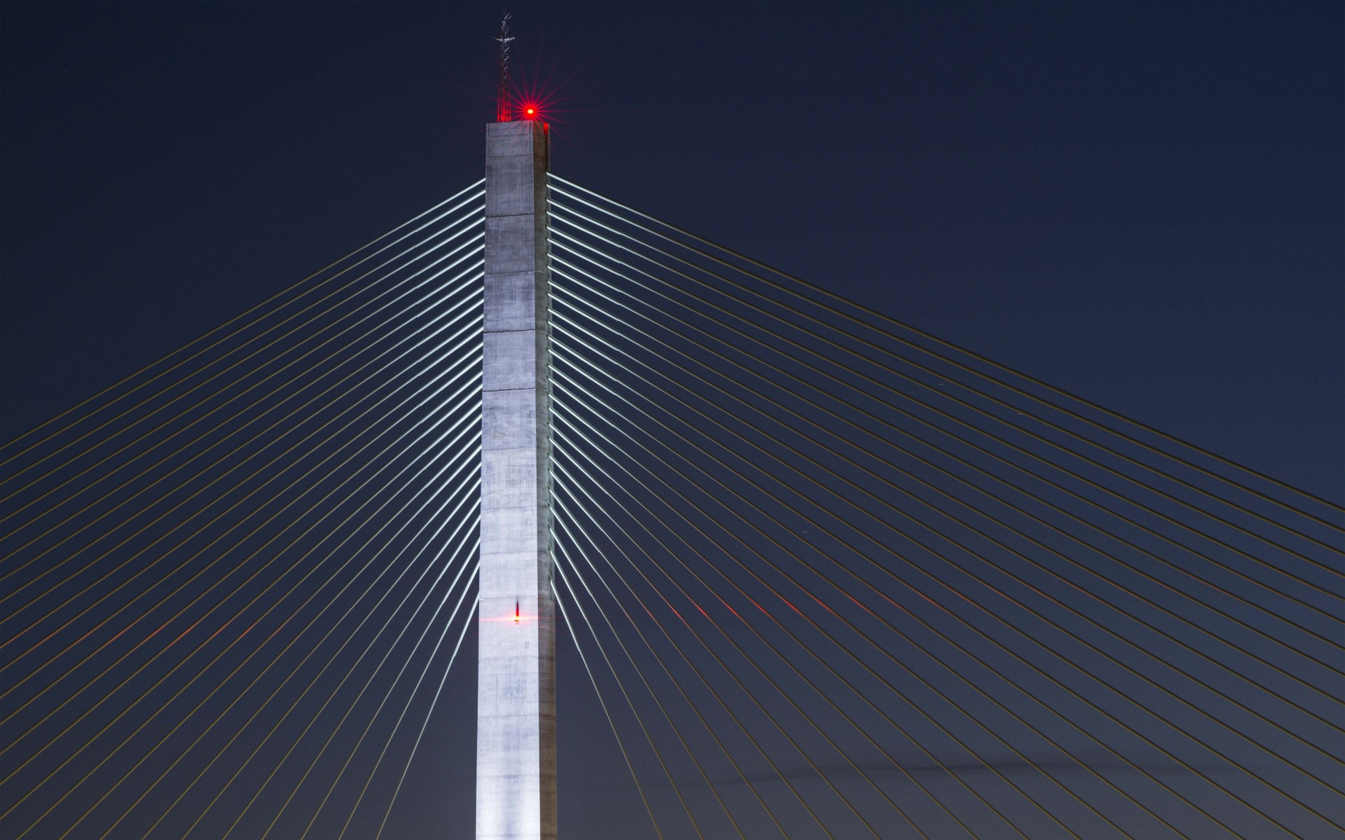 The Lumenbeam luminaires grace the support cables and the pylon itself.  – James Newton