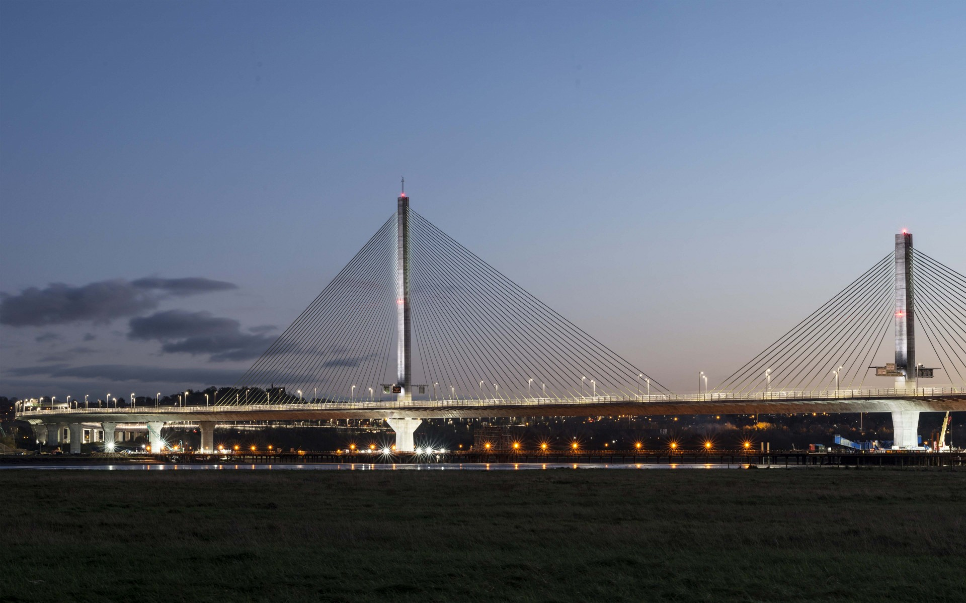 The three-pylon, cable-stayed Mersey Gateway Bridge is a six-laned landmark structure in northwest England, providing a much-needed new crossing of the River Mersey.  – James Newton