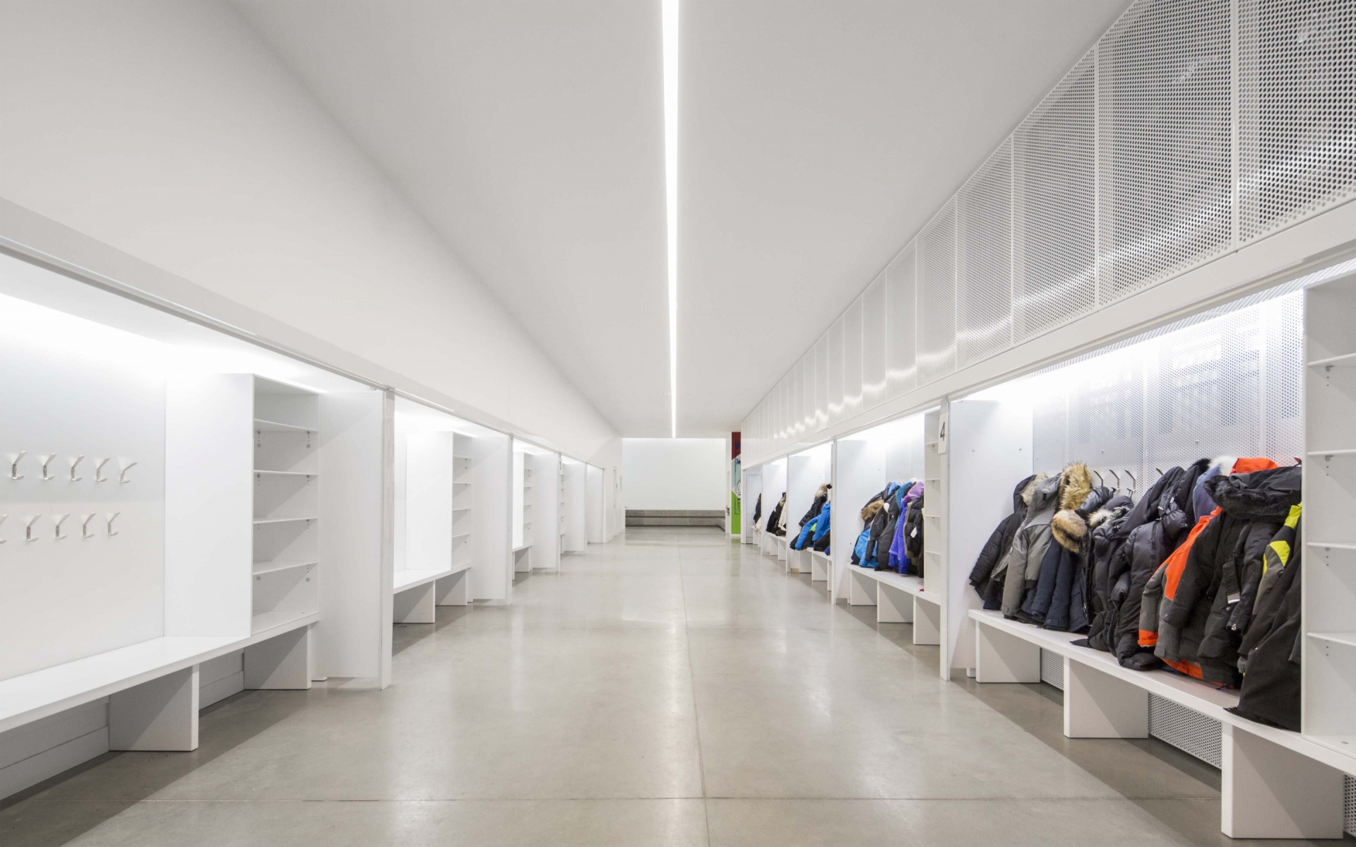 Lumenline Surface Ceiling Mounted luminaires were also used in the student locker room downstairs, effortlessly integrating to the ceiling and evenly lighting the space.  – Stéphane Brügger