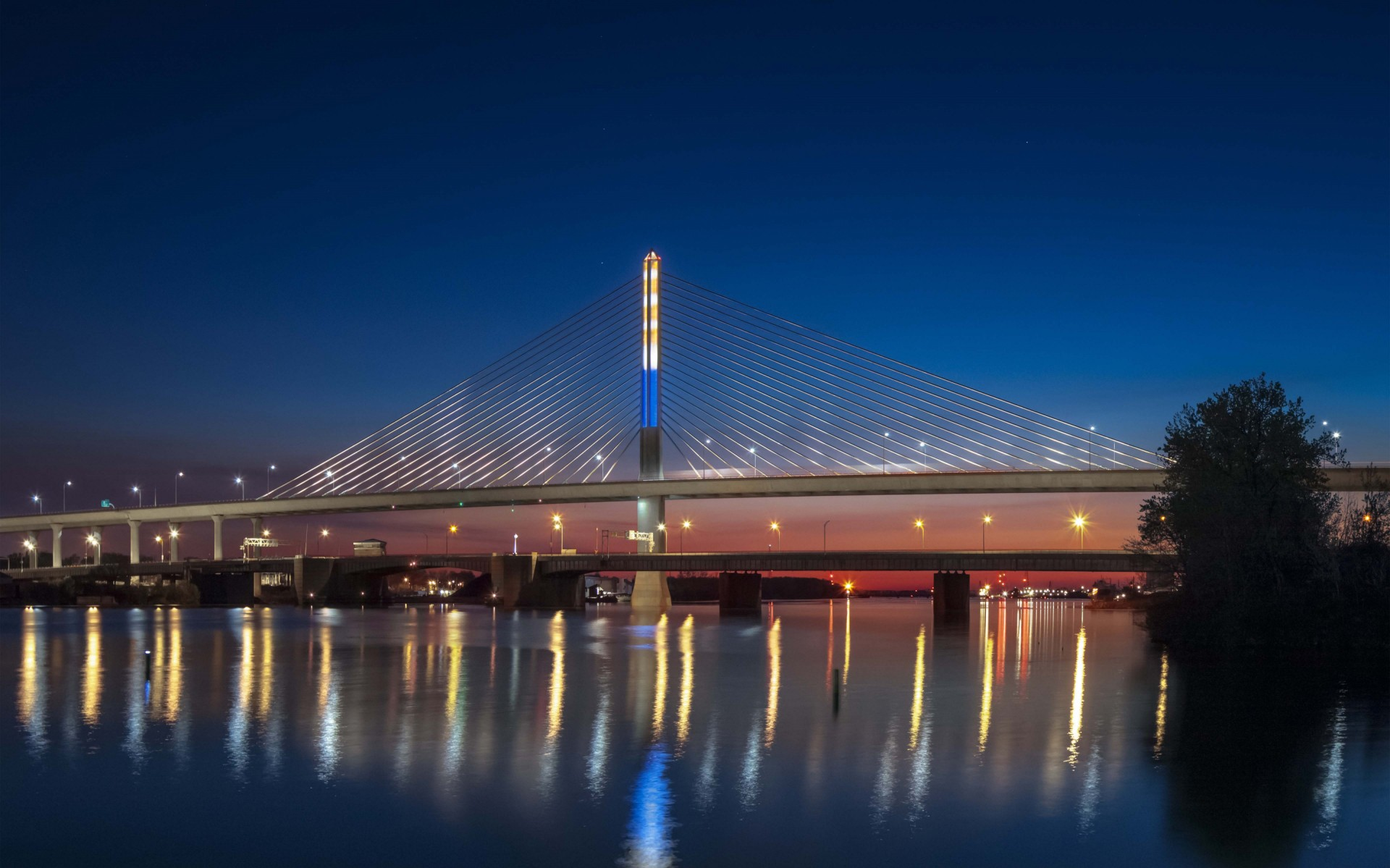The 400-foot-high, glass-enclosed tower of the cable-stayed bridge known as the Veterans' Glass City Skyway (VGCS) is an incredible achievement and has become a symbol of Toledo itself. – Feinknopf Photography