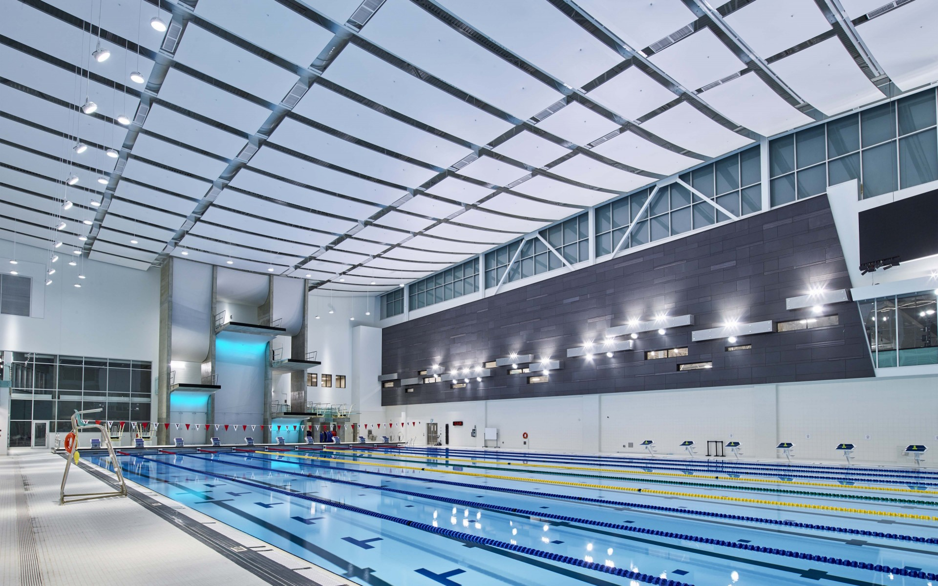 While the majority of Lumenbeam Extra Large luminaires are pendant mounted from the ceiling, others were yoke-mounted of the walls and aimed to provide more precise illumination. – Ian Grant