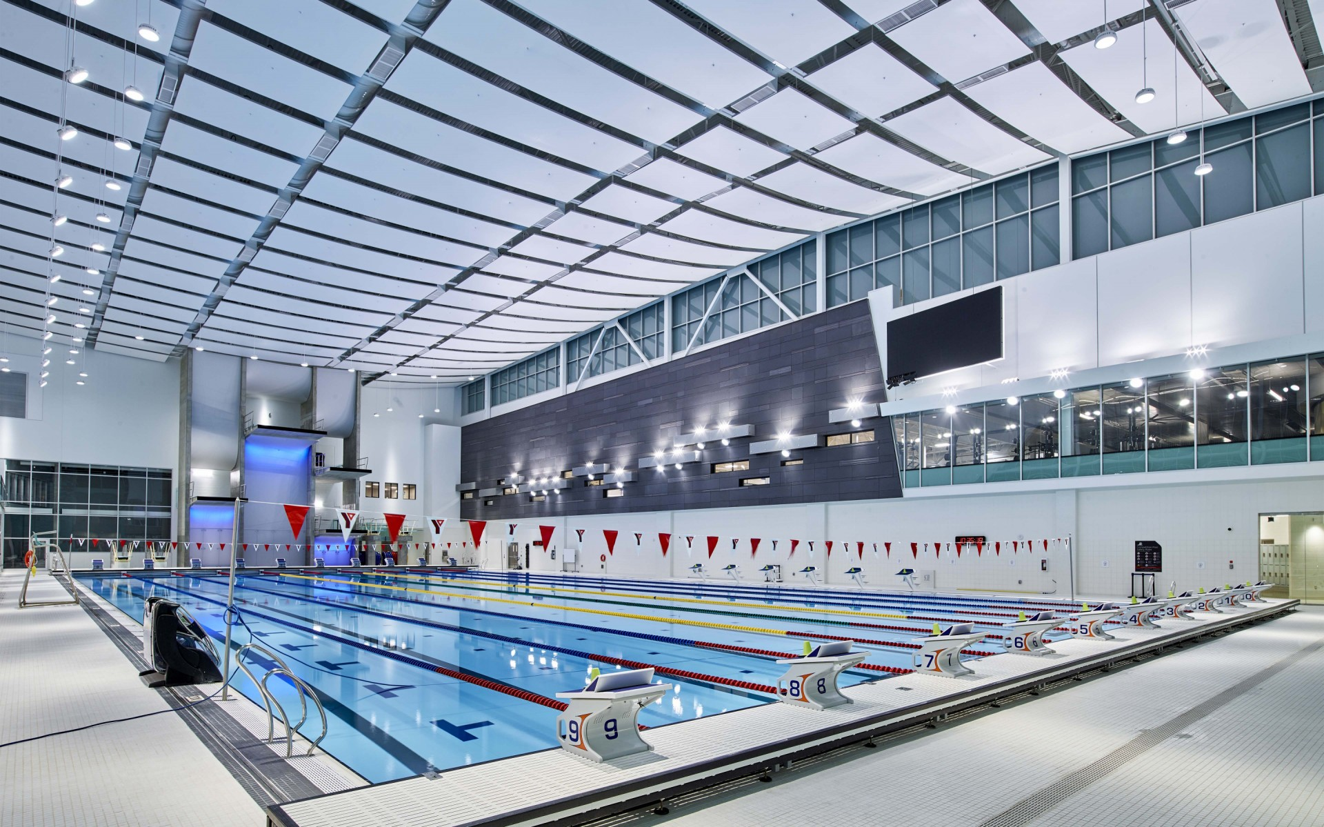 To provide a uniform aesthetic and a phenomenal quality of light for both the recreation and competitive aquatic facilities, SMP Lighting chose Lumenpulse Lumenbeam luminaires. – Ian Grant