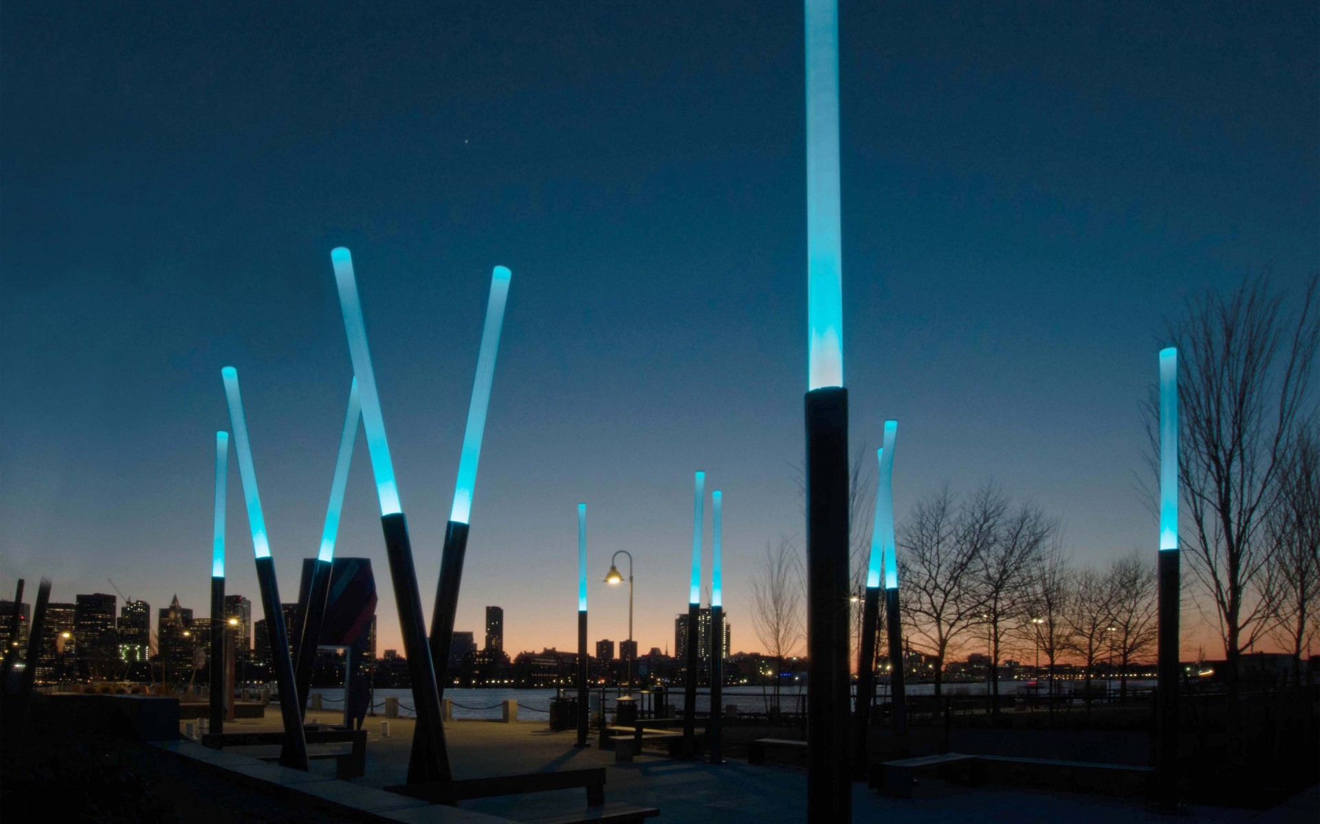 """In order to give the outdoor area a """"wow"""" factor that would draw people into the site, the stylized Element Columns were fashioned and installed to look like leaning wands of light. – Tracy Shankle"""